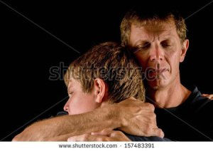 stock-photo-father-crying-hugs-teenage-son-closeness-forgiveness-loss-transition-solace-157483391